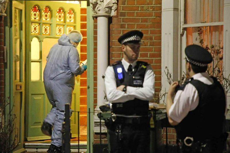 Forensic officers and police at the scene in Brixton where a woman was stabbed to death (NIGEL HOWARD ©)