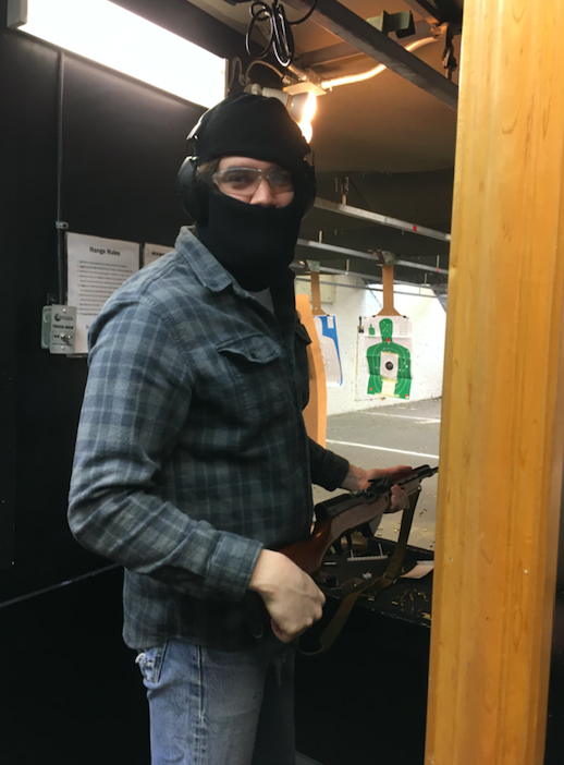 A masked member of the Socialist Rifle Association (SRA) at a Trigger Warning meet-up, Quickshot Shooting Range, Atlanta, in January 2019. (Courtesy of Mel Plaut)