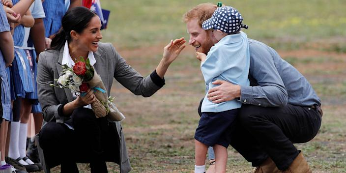 Prince Harry and Meghan Markle with Luke Vincent on October 17, 2018, in Dubbo, Australia.