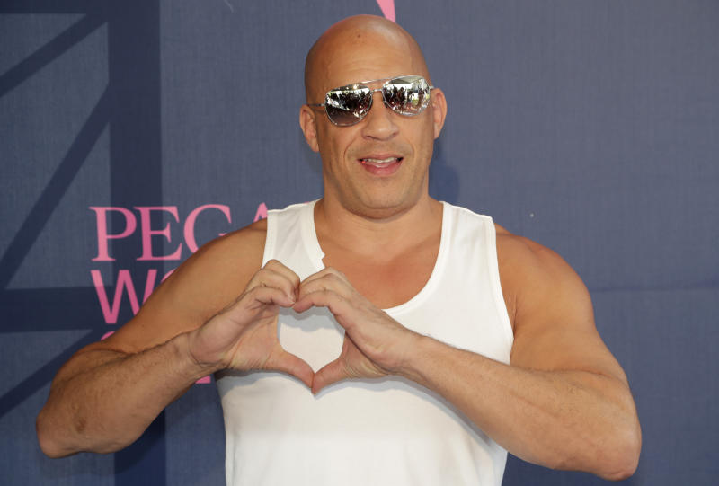 Actor Vin Diesel poses on the blue carpet before during the Pegasus World Cup Invitational horse race, Saturday, Jan. 25, 2020, at Gulfstream Park in Hallandale Beach, Fla. (AP Photo/Lynne Sladky)