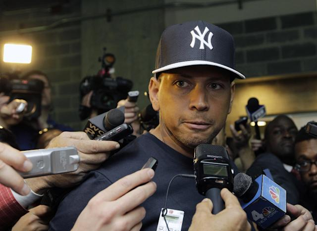 FILE - In this April 1, 2013, file photo, New York Yankees' Alex Rodriguez talks to reporters outside the Yankees' clubhouse in New York. (AP Photo/Kathy Willens, File)