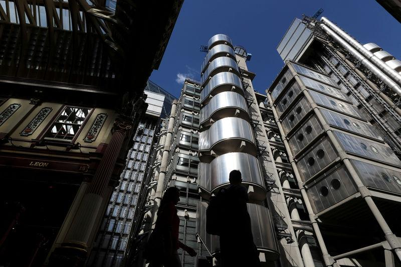 FILE PHOTO: People walk outside Lloyd's of London's headquarters in the City of London