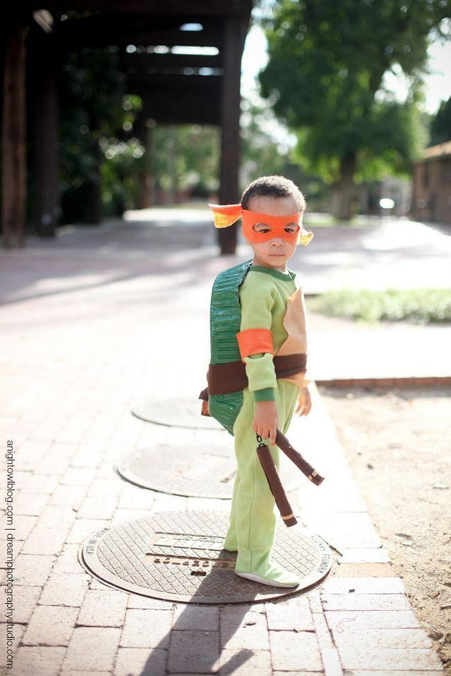 """<p>The kids might all be about Captain America and Iron Man these days, but nothing beats a classic like the nunchuck-wielding, pizza-munching Teenage Mutant Ninja Turtles. This super-easy costume is made from footie pajamas, so it's super-comfy, too!</p><p><a class=""""link rapid-noclick-resp"""" href=""""https://www.amazon.com/Leveret-Footed-Cotton-Pajama-Uniform/dp/B08CK4YPWD/?tag=syn-yahoo-20&ascsubtag=%5Bartid%7C10055.g.29516206%5Bsrc%7Cyahoo-us"""" rel=""""nofollow noopener"""" target=""""_blank"""" data-ylk=""""slk:SHOP FOOTIE PJS"""">SHOP FOOTIE PJS</a></p><p><em><a href=""""https://www.anightowlblog.com/easy-teenage-mutant-ninja-turtle-costume/"""" rel=""""nofollow noopener"""" target=""""_blank"""" data-ylk=""""slk:Get the tutorial at A Night Owl Blog »"""" class=""""link rapid-noclick-resp"""">Get the tutorial at A Night Owl Blog »</a></em></p>"""