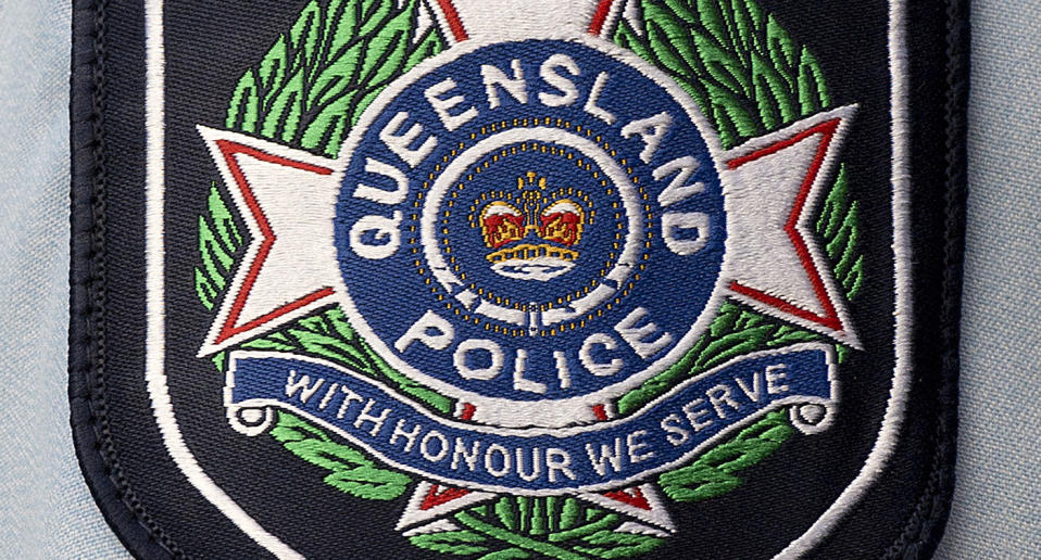 Stock photograph of a badge on the arm of a Queensland police officer in the Brisbane CBD, Friday, Feb. 28, 2014. (AAP Image/Dave Hunt) NO ARCHIVING