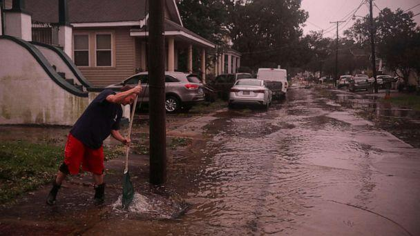 PHOTO: A resident clears storm drains after the eye of Hurricane Zeta passes over on Oct. 28, 2020, in Arabi, La. A record seven hurricanes have hit the Gulf Coast in 2020, bringing prolonged destruction to the area. (Sandy Huffaker/Getty Images)