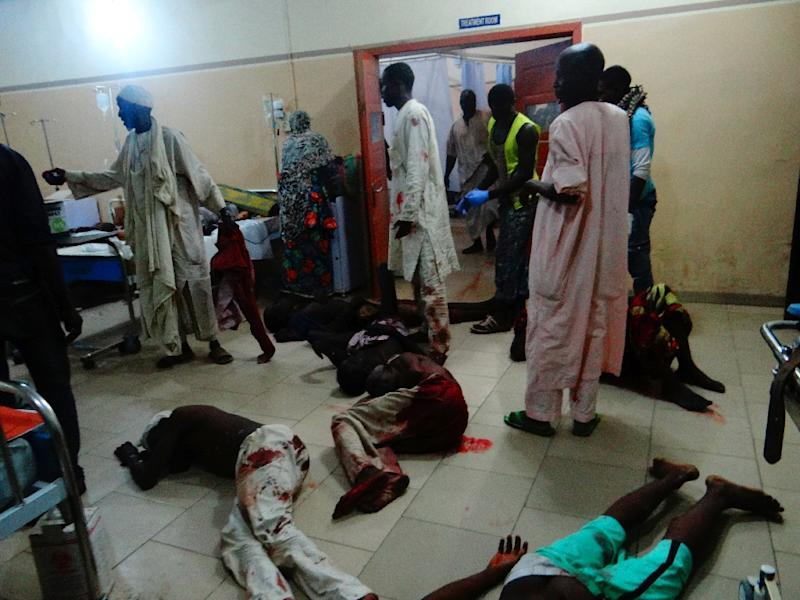 Injured victims of a female suicide bomber lie on the floor awaiting medical attention as beds were no longer available at a Maiduguri hospital in northeastern Nigeria