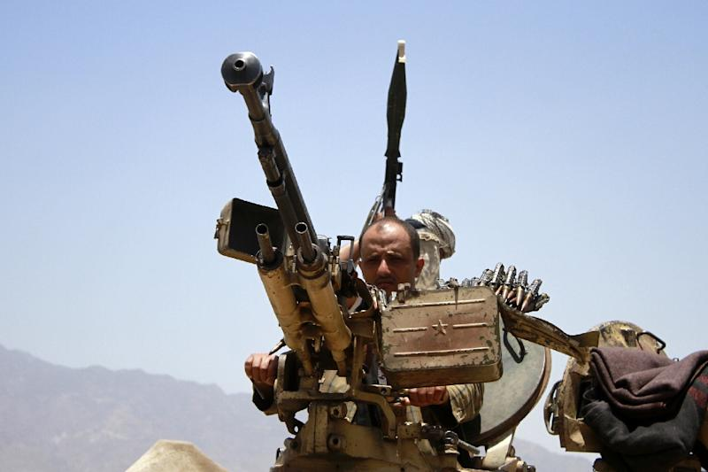 Armed Yemeni tribal gunmen of the Popular Resistance Committees loyal to fugitive President Abedrabbo Mansour Hadi stand on a tank as they hold a position in the southern city of Taez on April 29, 2015