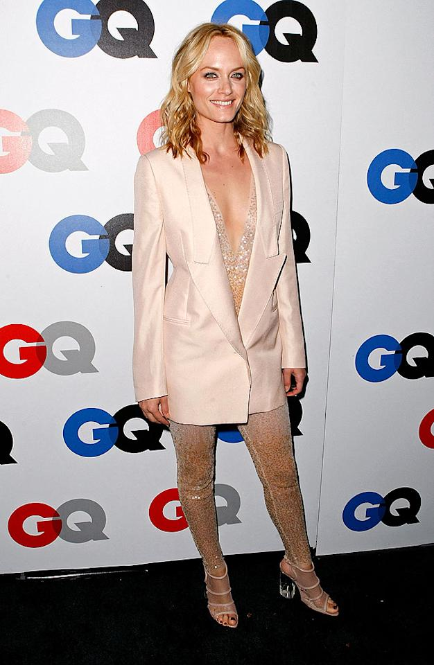"Amber Valetta put her supermodel status in jeopardy when she attempted to rock a ridiculous ensemble consisting of a Stella McCartney jumpsuit, a peach blazer, and mesh sandals complete with clear heels. Classy! Michael Buckner/<a href=""http://www.gettyimages.com/"" target=""new"">GettyImages.com</a> - November 18, 2008"