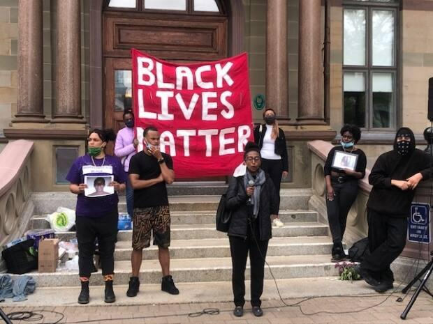 Attendees speak at of a Halifax City Hall vigil on June 5, 2020, which aimed to honour those lost to police brutality around the world.