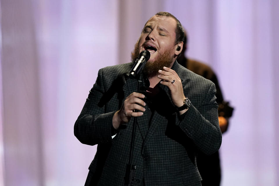 Luke Combs performs at the 56th annual Academy of Country Music Awards on Friday, April 16, 2021, at the Grand Ole Opry in Nashville, Tenn. The awards show airs on April 18 with both live and prerecorded segments. (AP Photo/Mark Humphrey)