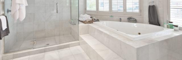Marble tub with steps.