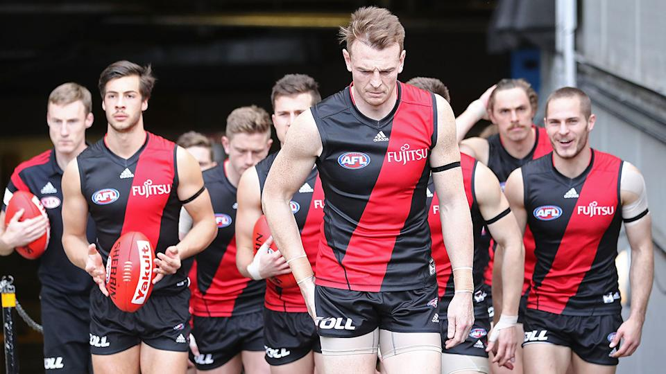 Brendon Goddard is seen here leading out Essendon during his time as club captain.