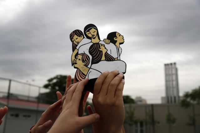 In this Wednesday, May 22, 2019 photo, members of Hestia FC Women's Refugee Soccer team raise the trophy of the Global Goals World Cup in Athens. Many of the players at Hestia FC weren't allowed to play or even watch soccer matches in their home countries. Hestia FC was set up by the Olympic Truce Centre, a non-government organization created in 2000 by the International Olympic Committee and Greek Foreign Ministry. (AP Photo/Thanassis Stavrakis)