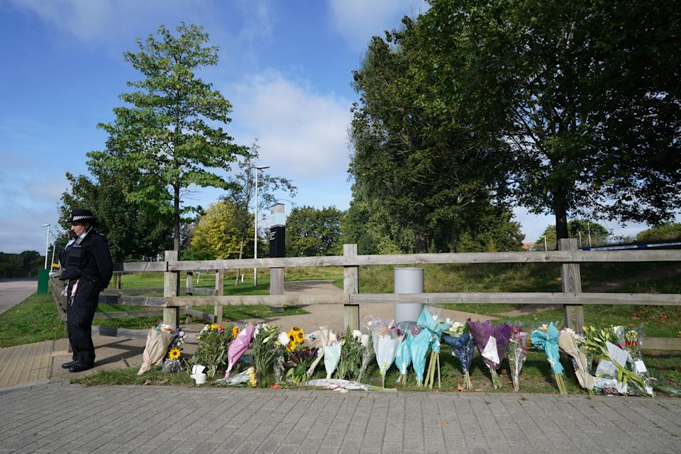 Floral tributes at Cator Park in Kidbrooke, south London, near to the scene where the body of Sabina Nessa was found. Officers investigating the killing of the 28-year-old teacher said she left her home on Astell Road and walked through Cator Park last Friday towards The Depot bar in Pegler Square, Kidbrooke Village, when she was attacked. Picture date: Thursday September 23, 2021.