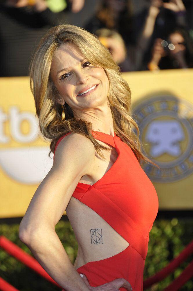 Actress Kyra Sedgwick arrives at the 18th Annual Screen Actors Guild Awards held at the Shrine Auditorium in Los Angeles, California on January 29, 2012. (Joe Klamar, AFP / Getty Images)