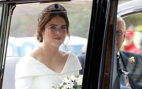 The bride, Princess Eugenie, arrives - Credit: Getty