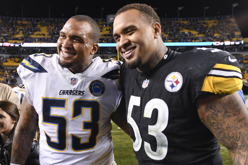 Los Angeles Chargers center Mike Pouncey and Pittsburgh Steelers center Maurkice Pouncey announced their retirement. (AP Photo/Don Wright, File)