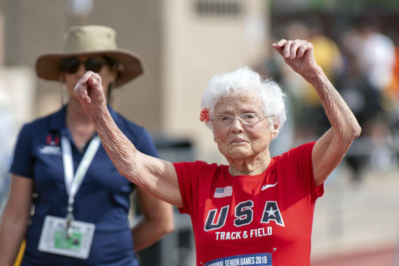 In this photo provided by the National Senior Games Association, 103-year-old Julia Hawkins, of Baton Rouge, La., celebrates after completing the 50-meter dash at the 2019 National Senior Games in Albuquerque, N.M., Monday, June 17, 2019. 
