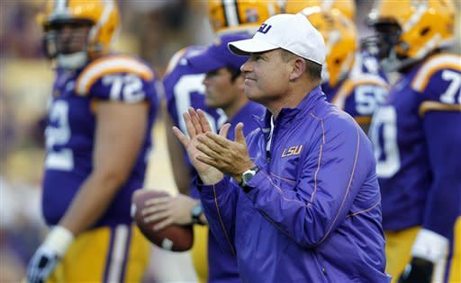 LSU head coach Les Miles claps for his team before their NCAA college football game against Idaho in Baton Rouge, Saturday, Sept. 15, 2012. (AP Photo/Gerald Herbert)
