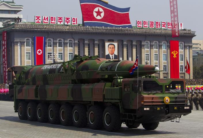 """In this Sunday, April 15, 2012 file photo, a North Korean vehicle carrying a missile passes by during a mass military parade in Pyongyang's Kim Il Sung Square to celebrate the centenary of the birth of the late North Korean founder Kim Il Sung. North Korea has moved a missile with """"considerable range"""" to its east coast, South Korean Defense Minister Kim Kwan-jin said Thursday, April 4, 2013 but he added that there are no signs that Pyongyang is preparing for a full-scale conflict. The report came hours after North Korea's military warned that it has been authorized to attack the U.S. using """"smaller, lighter and diversified"""" nuclear weapons. It was the North's latest war cry against America in recent weeks, with the added suggestion that it had improved its nuclear technology. (AP Photo/David Guttenfelder, File)"""