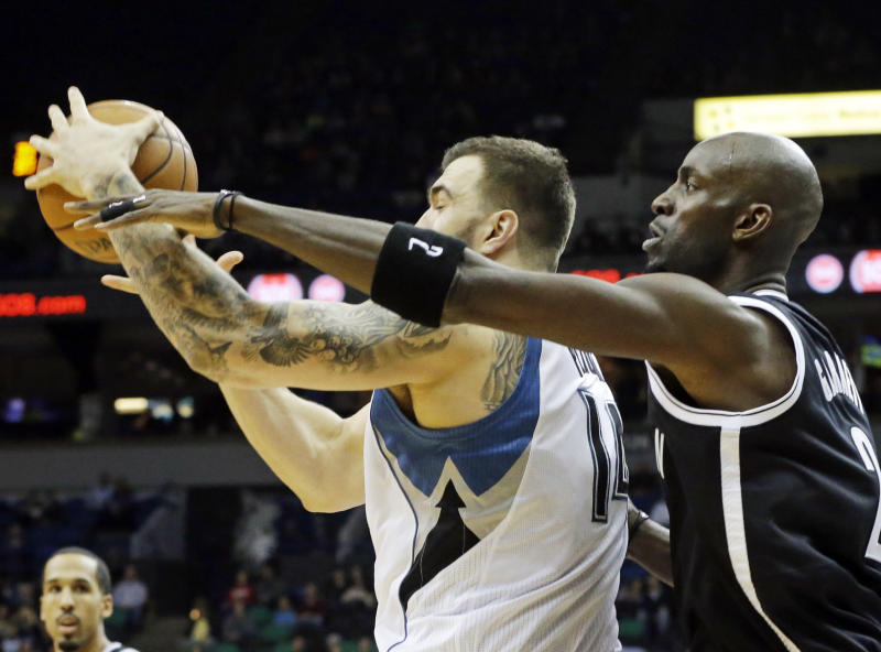 Love, Wolves beat KG for 1st time, 111-81