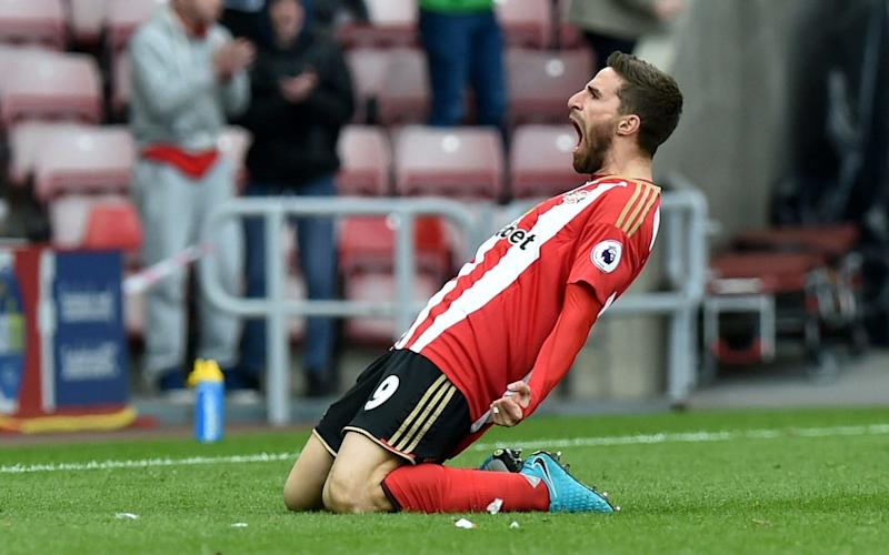 Fabio Borini slides in front of his manager after scoring a late equaliser for Sunderland against West Ham - Rex Features