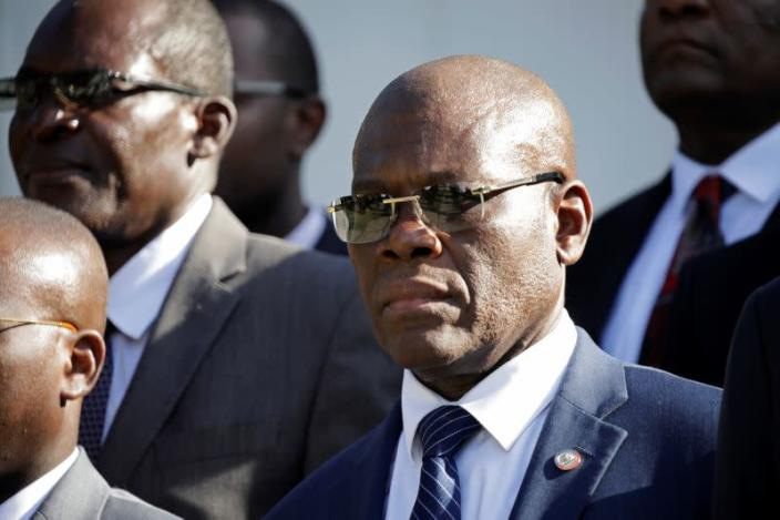 FILE PHOTO: Haiti's Prime Minister Joseph Jouthe stands for the national anthem at the end of his inauguration ceremony in the National Palace of Port-au-Prince