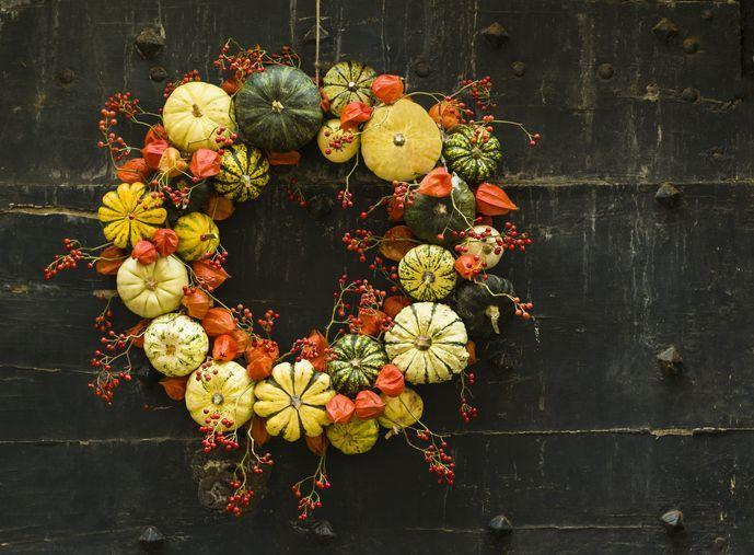 """<p>This handmade wreath of small pumpkins and zucchini features all the <a href=""""https://www.countryliving.com/home-design/color/g28634211/best-fall-color-schemes/"""" rel=""""nofollow noopener"""" target=""""_blank"""" data-ylk=""""slk:rich colors of fall"""" class=""""link rapid-noclick-resp"""">rich colors of fall</a>.</p>"""