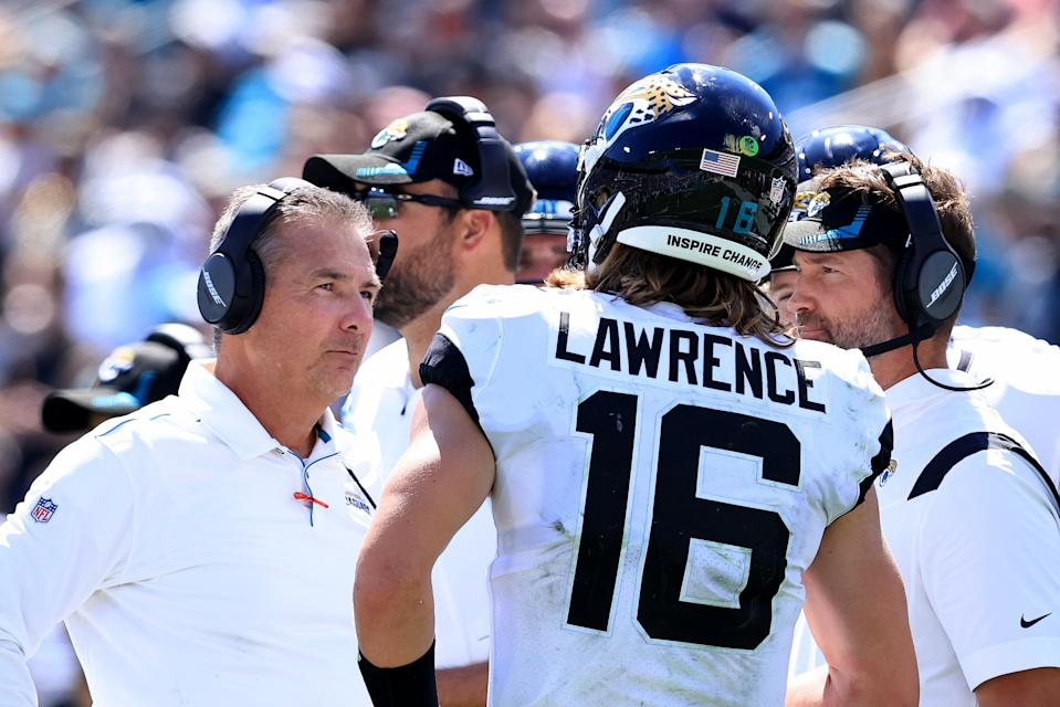 JACKSONVILLE, FLORIDA - SEPTEMBER 26: Head coach Urban Meyer (L) of the Jacksonville Jaguars speaks with Trevor Lawrence #16 during the game against the Arizona Cardinals at TIAA Bank Field on September 26, 2021 in Jacksonville, Florida. (Photo by Sam Greenwood/Getty Images)