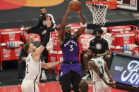 Toronto Raptors' OG Anunoby (3) dunks between Brooklyn Nets' Blake Griffin (2) and Kyrie Irving during the second half of an NBA basketball game Wednesday, April 21, 2021, in Tampa, Fla. (AP Photo/Mike Carlson)