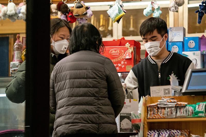 BEIJING, CHINA - FEBRUARY 9, 2020: People in face masks in a shop; since 2019, China has been hit by an outbreak of the 2019-nCoV coronavirus (officially known in China as NCP); as of 9 February 2020, the number of people in China infected with the new coronavirus has risen over 37,000, with the death toll reaching more than 800. Artyom Ivanov/TASS (Photo by Artyom Ivanov\TASS via Getty Images)