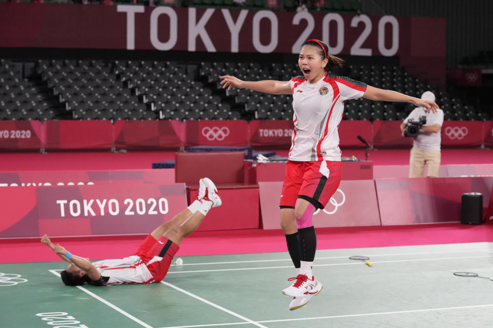 Indonesia's Greysia Polii, right, and Apriyani Rahayu celebrate after defeating China's Chen Qing Chen and Jia Yi Fan during their women's doubles gold medal match at the 2020 Summer Olympics, Monday, Aug. 2, 2021, in Tokyo, Japan. (AP Photo/Dita Alangkara)