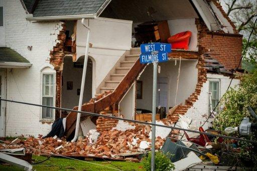 <p>A building is damaged as a tornadohits Thurman, Iowa. At least two people were killed in Oklahoma after tornadoes swept through the Midwestern United States late Saturday and early Sunday, leaving destruction in their wake, local media reported.</p>