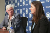 Catie Griggs is introduced as the Seattle Mariners' new president of business operations by John Stanton, the team's chairman and managing partner, during a baseball press conference in Seattle on Wednesday, July 28, 2021, (AP Photo/Jason Redmond)