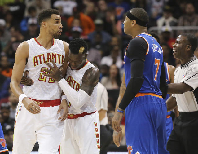 """<a class=""""link rapid-noclick-resp"""" href=""""/nba/teams/atl/"""" data-ylk=""""slk:Atlanta Hawks"""">Atlanta Hawks</a> guard Dennis Schroder and an official separate <a class=""""link rapid-noclick-resp"""" href=""""/nba/players/4141/"""" data-ylk=""""slk:Thabo Sefolosha"""">Thabo Sefolosha</a> and <a class=""""link rapid-noclick-resp"""" href=""""/nba/teams/nyk/"""" data-ylk=""""slk:New York Knicks"""">New York Knicks</a> forward <a class=""""link rapid-noclick-resp"""" href=""""/nba/players/3706/"""" data-ylk=""""slk:Carmelo Anthony"""">Carmelo Anthony</a> after they were called for technical fouls during the first half of an NBA basketball game on Wednesday, Dec. 28, 2016, in Atlanta. Anthony was ejected from the game. (Curtis Compton/Atlanta Journal-Constitution via AP)"""