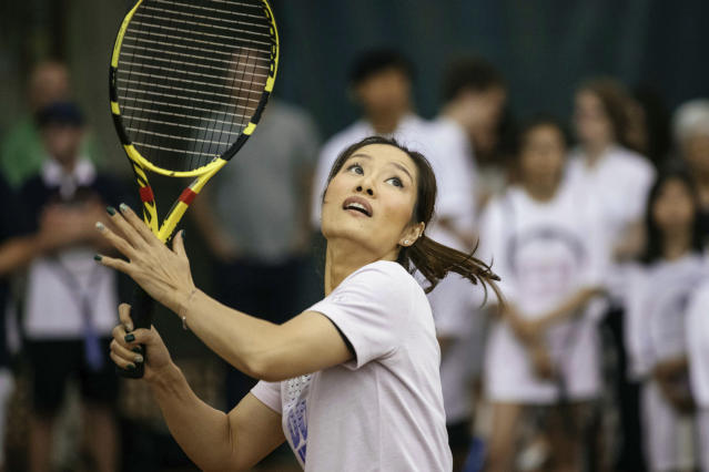 Two-time Grand Slam champion Li Na serves the ball during the tennis clinic she led at the Sutton East Tennis Club Thursday, July 18, 2019, in New York. Li Na will be inducted into the Tennis Hall of Fame on Saturday, July 20. (AP Photo/Kevin Hagen)
