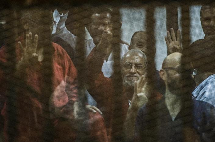 Egyptian Muslim Brotherhood leader Mohamed Badie (C) gestures from the defendants cage. The authorities have waged a deadly crackdown against the Brotherhood since the army overthrew Islamist president Mohamed Morsi in 2013 (AFP Photo/Khaled Desouki)