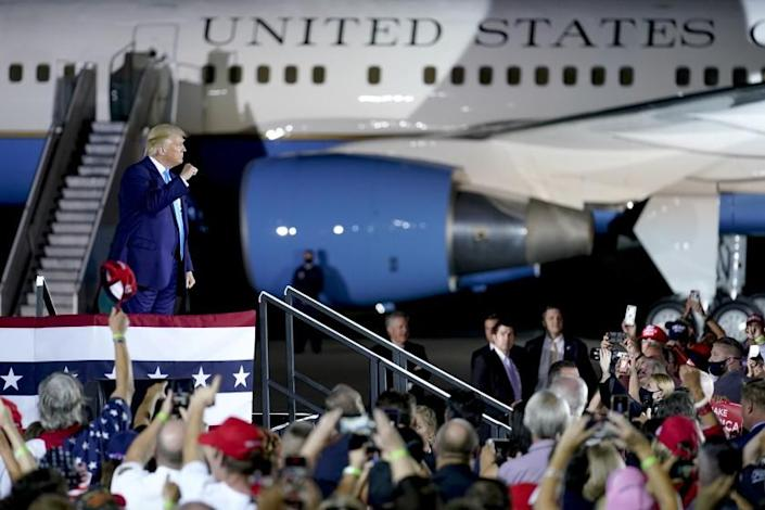 """President Donald Trump cheers with a crowd at a campaign event at the Arnold Palmer Regional Airport Thursday in Latrobe, Pa. <span class=""""copyright"""">(Keith Srakocic / Associated Press)</span>"""