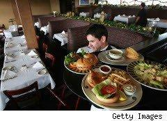 Waiter serves a tray of food
