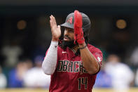 Arizona Diamondbacks' Henry Ramos applauds play as he leads off second base after his two-run double against the Seattle Mariners in the sixth inning of a baseball game Sunday, Sept. 12, 2021, in Seattle. (AP Photo/Elaine Thompson)
