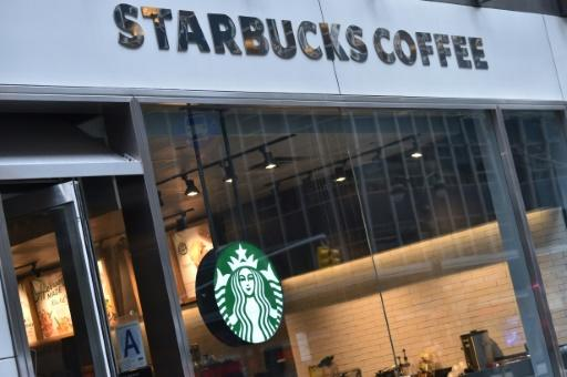 Starbucks has sought to contain outrage after the arrest of two young black men at one of its outlets in Philadelphia