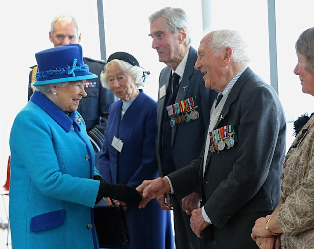 The Queen meets Mrs K Foster, Wing Commander Paul Farnes and Squadron Leader Tom Pickering as she visits the National Memorial to the Few (Getty)