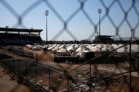 Tents are set at the old baseball venue of the former Hellenikon Olympic complex, which is used as a shelter for refugees and migrants, in Athens, Greece, July 13, 2016. Picture taken July 13, 2016. REUTERS/Alkis Konstantinidis