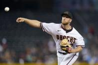 Arizona Diamondbacks starting pitcher Merrill Kelly throws against the Milwaukee Brewers during the first inning of a baseball game Monday, June 21, 2021, in Phoenix. (AP Photo/Ross D. Franklin)