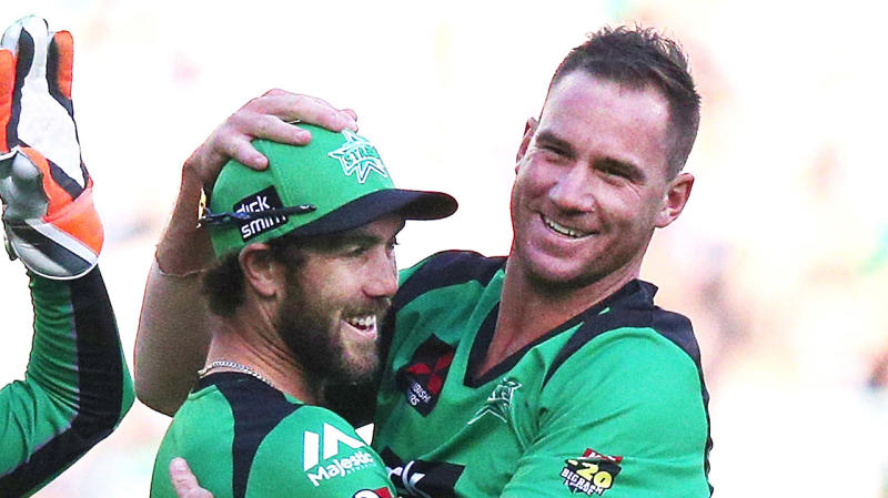 Glenn Maxwell and John Hastings celebrating a wicket for the Melbourne Stars.
