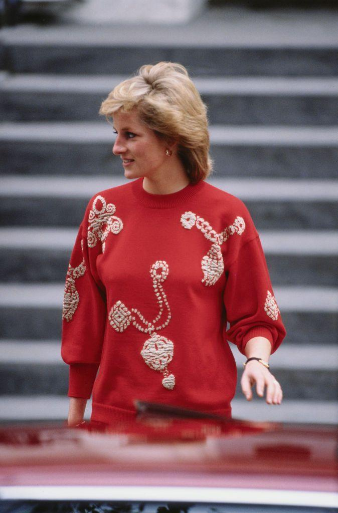 """<p>The Princess dropped Prince Harry off at his first day of school in 1989 wearing a sweater that says, """"Oh, family heirlooms? Yeah, I've got a few."""" <br></p>"""