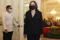 U.S. Vice President Kamala Harris, right, is pictured before a bilateral meeting with Singapore's Prime Minister Lee Hsien Loong at the Istana in Singapore Monday, Aug. 23, 2021. (Evelyn Hockstein/Pool Photo via AP)