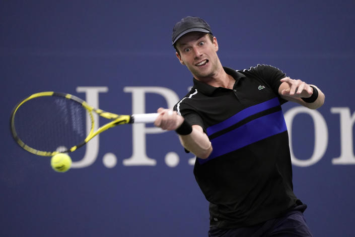 Botic Van de Zandschulp, of the Netherlands, returns to Diego Schwartzman, of Argentina, during the fourth round of the US Open tennis championships, Sunday, Sept. 5, 2021, in New York. (AP Photo/John Minchillo)