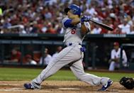 Los Angeles Dodgers' Jerry Hairston Jr. follows through on a two-run single during the second inning of a baseball game against the St. Louis Cardinals on Wednesday, Aug. 7, 2013, in St. Louis. (AP Photo/Jeff Roberson)