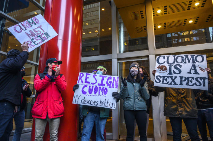 Demonstrators rally for New York Gov. Andrew Cuomo's resignation in front of his Manhattan office in New York, Tuesday, March 2, 2021. Cuomo has avoided public appearances for days as some members of his own party call for him to resign over sexual harassment allegations. (AP Photo/Brittainy Newman)
